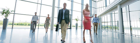 Professionals walking in an office building