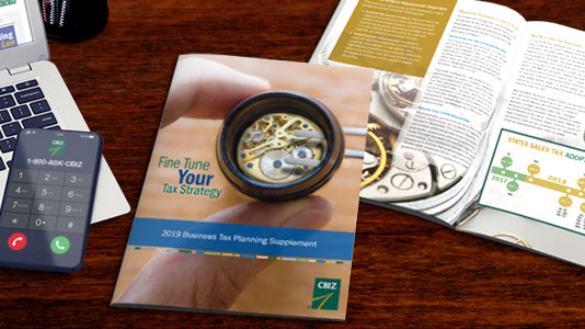 Flat lay of three pages form the CBIZ 2018 Guide To The New Tax Law