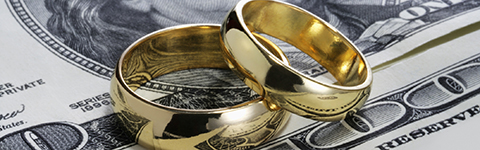 Two rings laying on top of money